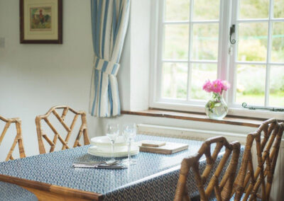 The dining area at Bratton Mill Cottage, Bratton Fleming