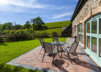 The patio & alfresco dining area at Dashel Cottage, Countisbury