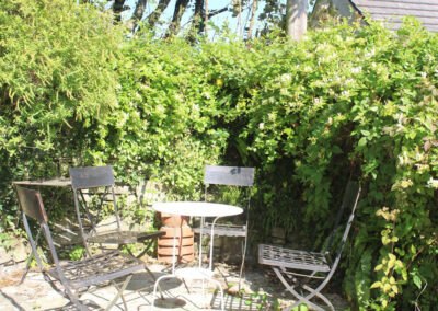 The small terraced area & cottage style garden at Old Church House, Brayford