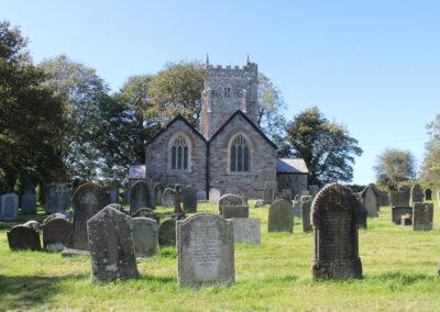 The rear of the garden at Old Church House, Brayford overlooks the churchyard