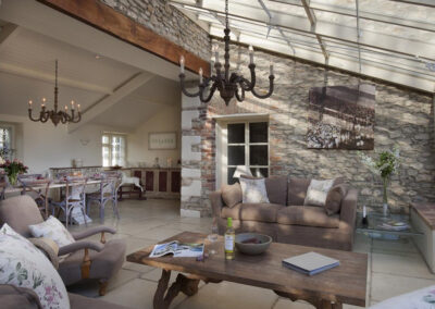 The conservatory living area at Raleigh Estate, Combe Raleigh