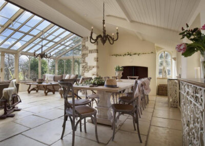 The conservatory dining area at Raleigh Estate, Combe Raleigh
