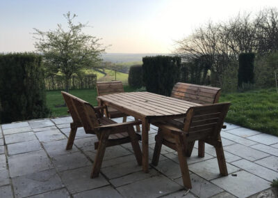 The patio & far reaching countryside view at The Roundhouse, West Anstey