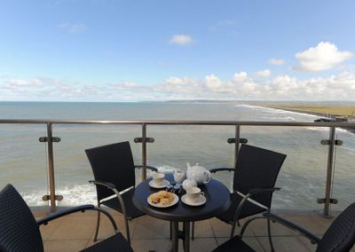 The furnished balcony is ideal for al fresco dining @ Tidal Bay, Horizon View, Westward Ho!