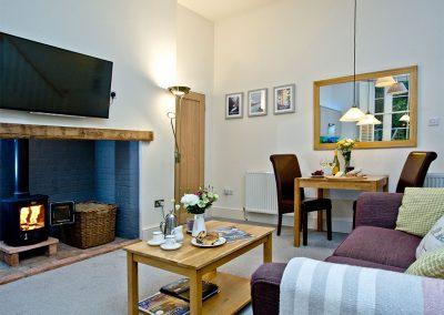 The living area at Wisteria Cottage, Cockington Cottages, Cockington