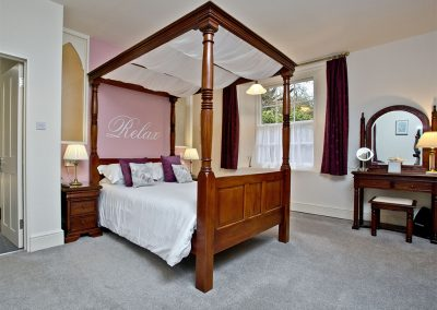 The bedroom at Wisteria Cottage, Cockington Cottages, Cockington